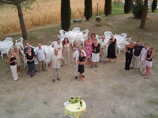 Large group enjoying pre-dinner drinks on holiday in Italy for a birthday celebration