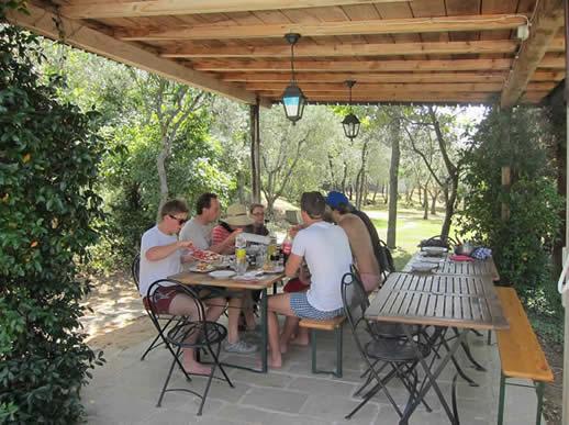 Outdoor dining at Villa degli Olivi. Venue for family reunion.
